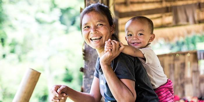 Khammouane Province, Laos, 2017.  Community members in a small rural village in Laos on 12 June, 2017:  a mother with her son.  Throughout its work, Lao Red Cross, supported by International Federation of the Red Cross and Red Crescent Societies as well as other partners, promotes community-based disaster risk reduction and community resilience.