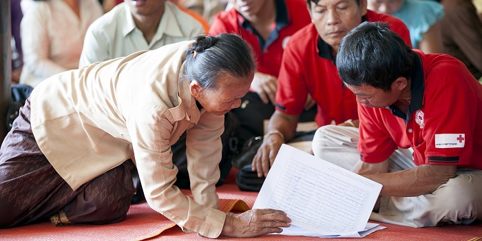 Khammouane Province, Laos, 2015  Planning checks. Members of Village Disaster Protection Units go over the schedule for a Community Based Disaster Risk Reduction simulation. The exercises and drills focus on disaster preparedness and response at village level, ensuring communities are equipped with skills to activate emergency plans and save lives.  Through the simulation project Lao Red Cross and partner French Red Cross, with support from the European Union, are improving safety for vulnerable communities.