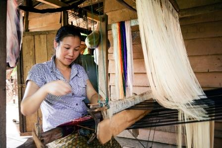 Khammouane Province, Laos, 2015 Handicrafts in action. Women are empowered through weaving and handicraft projects, raising money for their family and community. Photo taken during a Community Based Disaster Risk Reduction simulation. The exercises and drills focus on disaster preparedness and response at village level, ensuring communities are equipped with skills to activate emergency plans and save lives. Through the simulation project Lao Red Cross and partner French Red Cross, with support from the European Union, are improving safety for vulnerable communities.