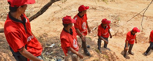 Khammouane Province, Laos, 2015 In line to fight fire. Village Disaster Protection Unit members form a water line to fight fire during a Community Based Disaster Risk Reduction simulation. The exercises and drills focus on disaster preparedness and response at village level, ensuring communities are equipped with skills to activate emergency plans and save lives. Through the simulation project Lao Red Cross and partner French Red Cross, with support from the European Union, are improving safety for vulnerable communities.