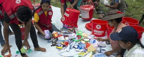 Myanmar 2015. Kalay. Aye Thar Yar village. Myanmar Red Cross local volunteers distributing hygien kits and shelter kits to flood affected people in Aye Thar Yar village. MRC local volunteers have been helping around the Kalay township area since the monsoon floods hit the area end of July.