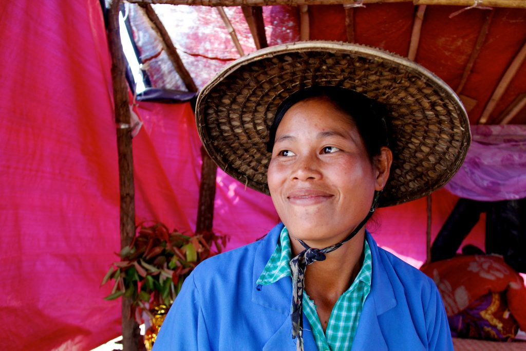 """14. Daw San Thida Tun, 27, Maw Like Kalay South village, Kalay, Sagaing and the rest of her village lost everything in floods in August 2015 have been able, through support from the Myanmar Red Cross, to restart their lives. They received a 500,000 MMK (approximately 385 USD) cash grant and were able to buy the plot of land that her new temporary house stands on, as well as install a well and to purchase some concrete foundation blocks to use as soon as her family has saved up enough money to buy the rest of the materials. """"I was so surprised when I heard about the money from the Red Cross! I didn't expect it at all. I had no idea how we were going to survive before this grant, so we were overjoyed when we heard we would be receiving this assistance from MRCS. If we hadn't received this, we would have had an extremely difficult time."""" Mandy George, IFRC"""