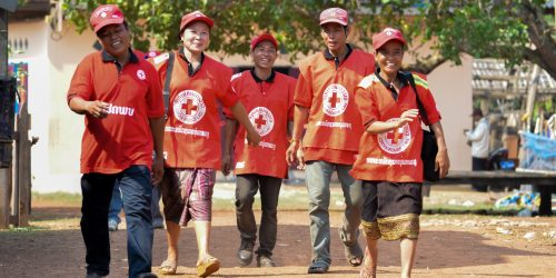 Khammouane Province, Laos, 2015 There is no I in teamwork. Village Disaster Protection Unit members share a laugh together following completion of a Community Based Disaster Risk Reduction simulation. The exercises and drills focus on disaster preparedness and response at village level, ensuring communities are equipped with skills to activate emergency plans and save lives. Through the simulation project Lao Red Cross and partner French Red Cross, with support from the European Union, are improving safety for vulnerable communities.