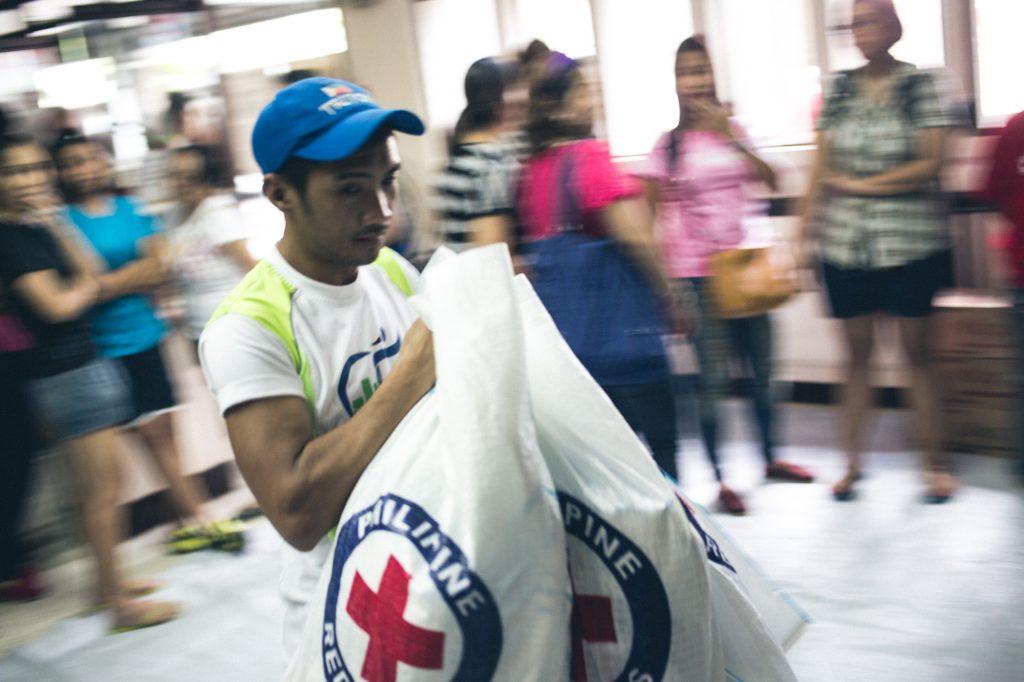 Philippines. Manila, 2013. Typhoon Haiyan struck Philippines 8th November, 2013. Volunteers and staff working with food items at Philippine Red Cross HQ. Jarkko Mikkonen/Finnish Red Cross.