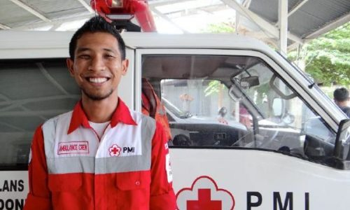 June 3, 2014. Banda Aceh, Indonesia. When he's not studying at university, Nur Hadi spends his time as a volunteer EMT for the Indonesian Red Cross. Determined to help his town stay safe during emergencies, he and other university students provide medical care during natural disasters, at the local soccer games, and for any other emergencies that happen in their town. The American Red Cross has funded EMT training for the volunteers and helped their local Red Cross branch—which was severely impacted by the 2004 Indian Ocean Tsunami—to develop its programs over the past ten years. Helping local Red Cross branches to be strong and self-sustaining is a vital piece of the American Red Cross's disaster preparedness work – ensuring that volunteers and first responders are ready to act in times of crisis. Photo by Jenelle Eli/American Red Cross