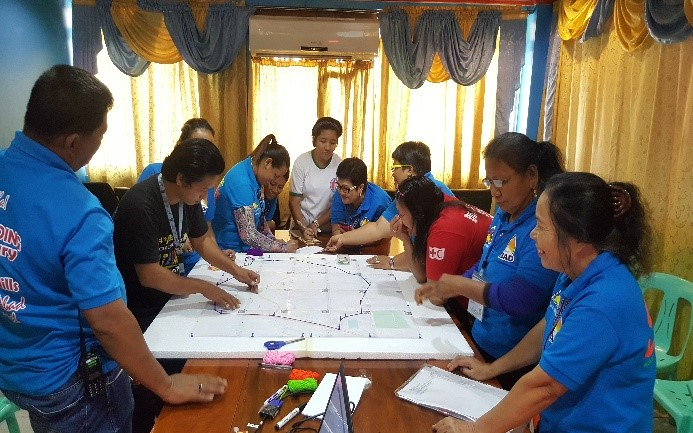 QGIS Re-Echo Workshop held last July 7, 2017. Brgy staff and volunteer are working on the identiication of the critical infrstuctures in their Brgy prior plotting it in the application. Photo by Philippine Red Cross.