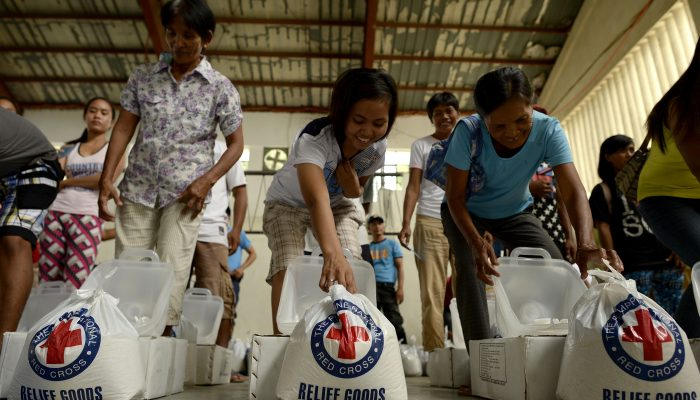 Flood affected residents of Barangay Delfin, Albano, Isabela, receive relief goods from Red Cross on October 20, 2015.Flood affected residents of Barangay Delfin, Albano, Isabela, receive relief goods from Red Cross on October 20, 2015.